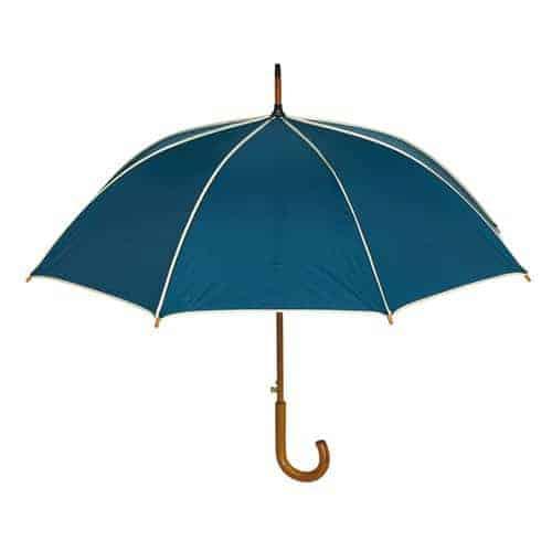 Beige och navy blå paraplyet